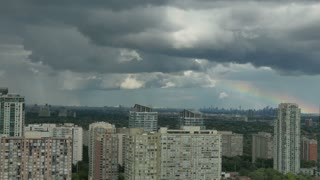 Time lapse shot of a rainbow passing over the greater Toronto area. Shot from Mississauga, Canada.