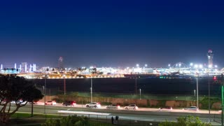 Time lapse shot of LAX airport with jet planes taking off at night
