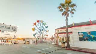 Timelapse in motion or hyperlapse in Newport Beach fun zone with ferris wheel