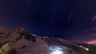 Timelapse night mountain snow