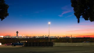 Timelapse of airport with jet planes taking off at sunset in 4K