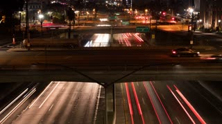 Timelapse of highway traffic lanes in Los Angeles at night.