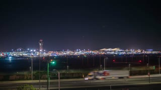 Timelapse of LAX airport with jet planes taking off at night