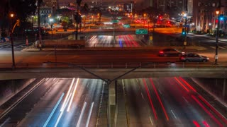 Timelapse shot of urban highway traffic lanes in Los Angeles at night