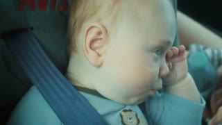 Tired Baby in Carseat