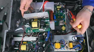 Top view. Hands of person assembling computer, system unit with the screwdriver