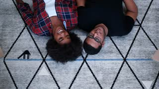 top view of Young mixed race Couple Relaxing Lying On The Floor After Moving To New Apartment