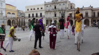 Traditional band performing show in the streets of Havana, Cuba. Cuban artists and acrobats on stilts playing music and singing for tourists in Old Havana