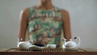 Traditional tea ceremony. Traditional process of tea drinking preparation. Traditional brewing tea. Woman is preparing green tea. Concept process of preparing chinese teapot and cup for ceremony