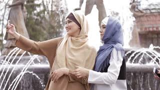 Two Beautiful Muslim Girl Using Smartphone
