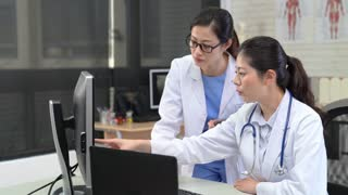 Two asian medical and surgical doctors consulting