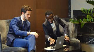 Two Young Businesspeople Having Discussion