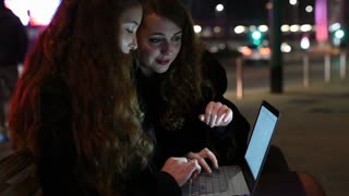 two young women  using computer