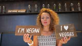 Vegan Woman in Healthy Eating Cafe. Healthy Lifestyle.