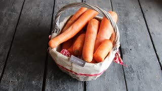 Vegetarian concept, tag and Carrot in the basket