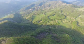 View from the drone, on a sunny day view of the terrain,trees, hills, the concept: ecology, bio.