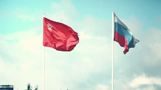 Waving flags of Russia and the Moscow Region. Slow motion shot