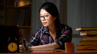 Asian Woman architect working late at home