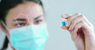 woman hand of a hospital medical expert shows the pill to be taken by patient in slow motion.