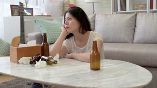 Depressed, stressed Asian Woman drinking