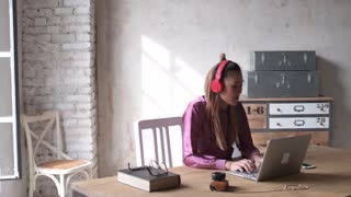 woman listening music using computer