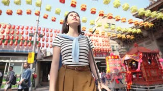 Tourist Asian Woman standing in the middle of the Tin Hau temple
