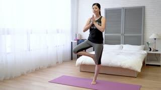 Asian woman doing yoga pose