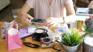 Woman Taking Pictures of Stylish Flat Lay With Coffee And Camera