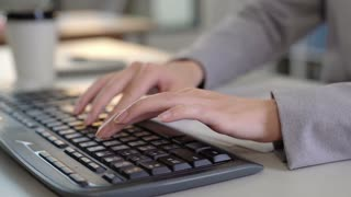 woman working at office on keyboard