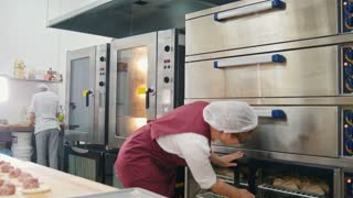 Working process in he bakery, cook checks raw pies in the refrigerator