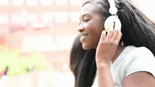 young beautiful afro woman listening music