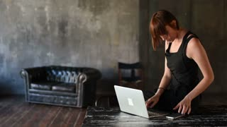 young beautiful woman indoor using computer