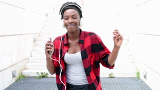 young beautiful woman listening music