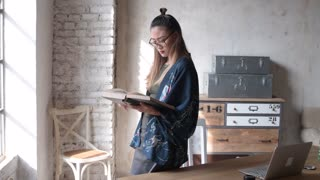 young business woman  reading book