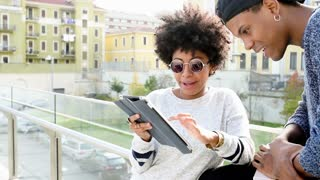 Young couple using tablet