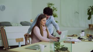 Young couple working together in an office. Start-up business. A man and woman making plans