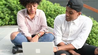 Young multiethnic couple using computer