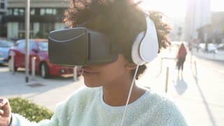 Young woman using 3D viewer