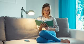 Young Woman With Book In Living Room