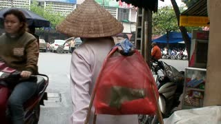 Vietmanese Person Walking Through Market
