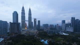 View at dusk of the illuminated Petronas Twin Towers, Kuala Lumpur City Centre KLCC, Malaysia, Kuala Lumpur, Asia, Time lapse