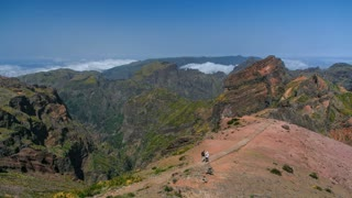 View down over the clouds from slopes of Pico do Arieiro, Madeira, Portugal timelapse 4K