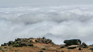 View down over the clouds with observation deck from slopes of Pico do Arieiro, Madeira, Portugal timelapse 4K