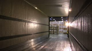 View From Within Semitruck Trailer As Pallets Are Loaded By Forklift