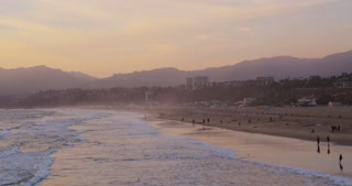 View of Beach and Mountains at Sunset