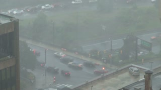 View of Firetruck Pulling Onto Bridge During Storm