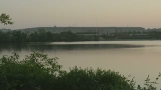 view of pentagon with river and bushes in foreground
