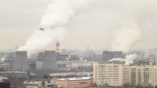 view of smocking pipes of Moscow winter day to Ozernaya street timelapse 4K