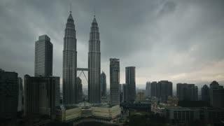 View of storm clouds swirling around the Petronas Twin Towers, Kuala Lumpur City Centre KLCC, Malaysia, Kuala Lumpur, Asia, Time lapse