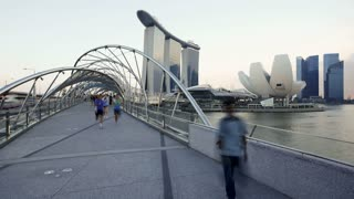 View of the Helix Bridge and Marina Bay Sands Singapore, Marina Bay, Singapore, Asia, Time lapse